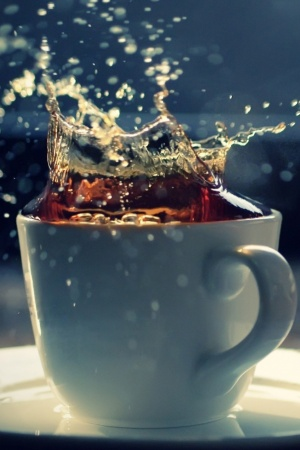 Splash In A Tea Cup Mobile Wallpaper