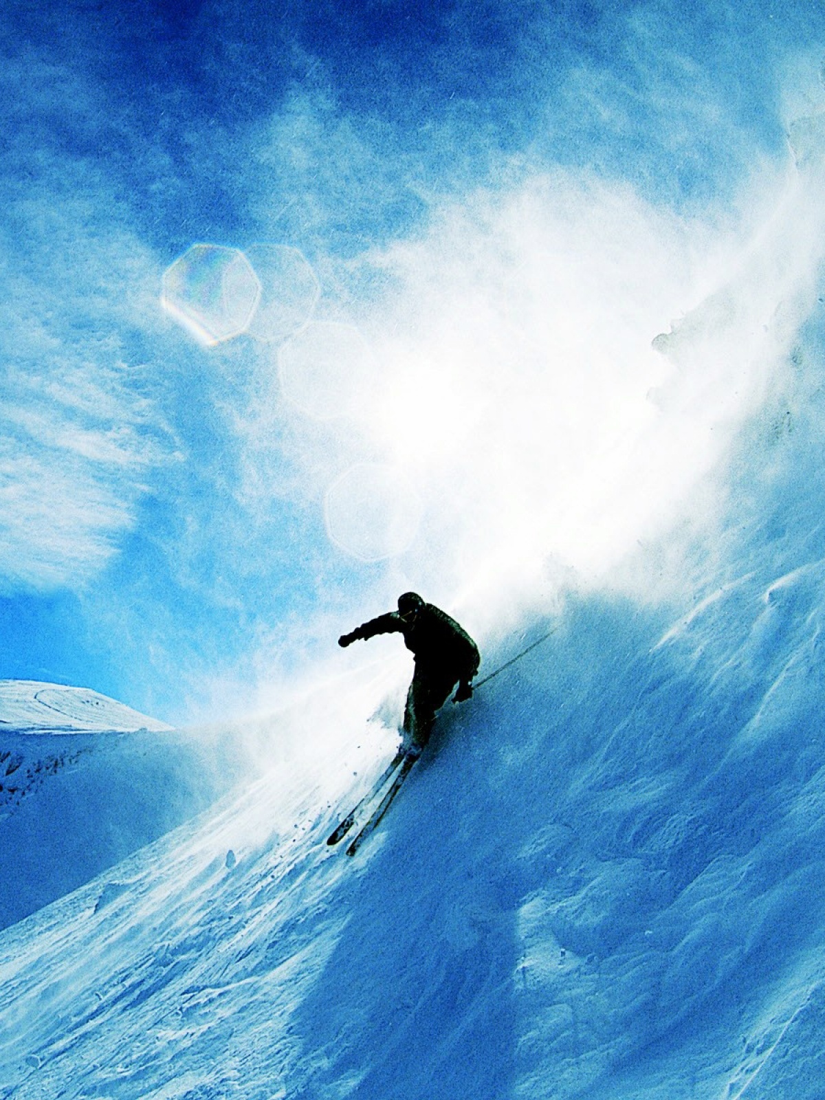 Skiing Over Snow Mobile Wallpaper