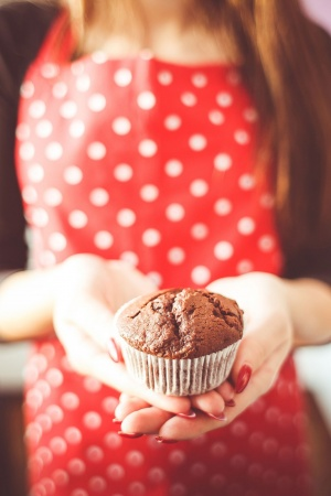 Little Homemade Muffin in Hands Mobile Wallpaper