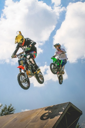 Two Crazy Jumping Pitbikers Mobile Wallpaper